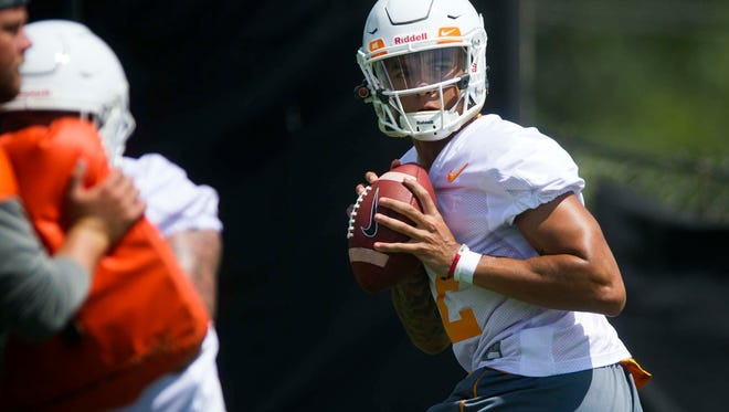 Quarterback Jarrett Guarantano prepares to throw a pass at the first University of Tennessee fall football practice of the year at Anderson Training Facility in Knoxville, Tenn. on Saturday, July 29, 2017.