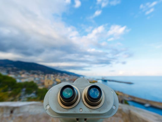 An old binoculars pointing on the city
