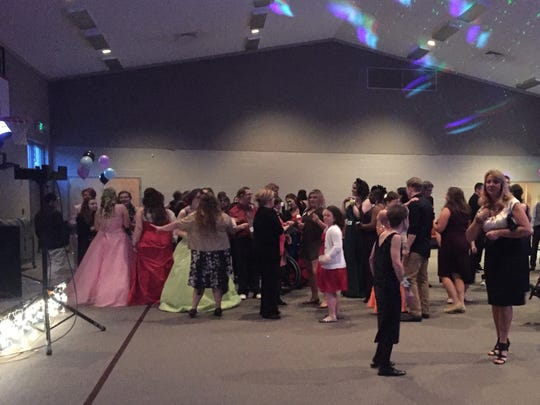 """A crowd takes to the dance floor at a past """"Night to Shine"""" prom."""