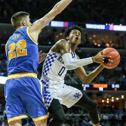 De'Aaron Fox shoots around UCLA's TJ Leaf in the second
