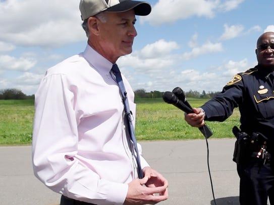 Julian C. Whittington, Bossier Sheriff, talks to the