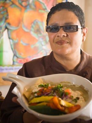 Chef Silvana Salcido Esparza of the Barrio Cafe with the enchiladas verde her mother made.