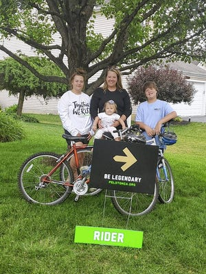 Hanim Shepherd, holding her 10-month-old daughter, Aurora, will ride 25 miles to support this year's Pelotonia, accompanied by daughter Larique, 15. The family, including Phillip, 10, has participated in other fundraising efforts to aid Pelotonia, which supports cancer research at Ohio State University's James Cancer Center and Solove Research Institute.