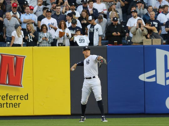 Yankees right fielder Aaron Judge warms up just before the first pitch of Game 5 of the ALCS against the Houston Astros on Wednesday, October 18, 2017.