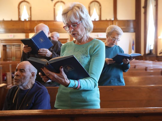 Anita Getler sings at the prayer service at the First Presbyterian Church in Hackensack on Wednesday.