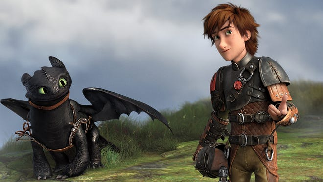 """Toothless and Hiccup in a scene from the animated motion picture """"How to Train Your Dragon 2."""""""
