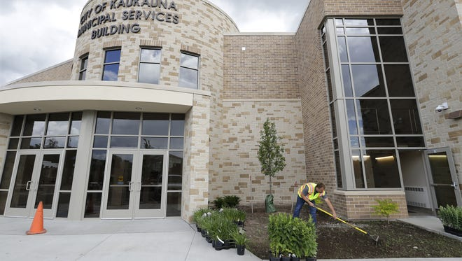Street foreman Tim Clark works on landscaping Monday at the entrance to the new City of Kaukauna Municipal Services Building,