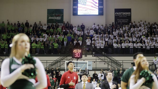 UW-Green Bay students stand during the national anthem before tipoff of a Horizon League men's basketball game on Feb. 16 at the Kress Center.