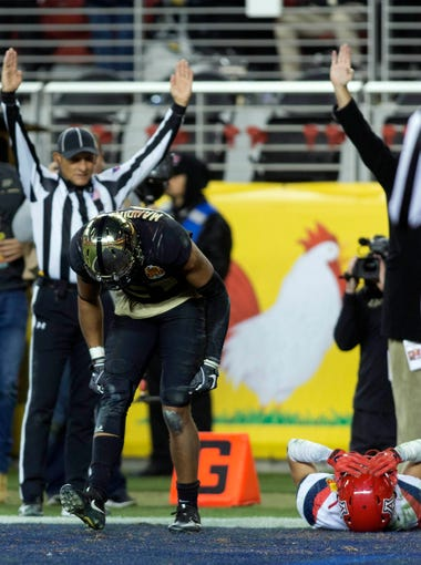 Dec 27, 2017; Santa Clara, CA, USA; Purdue Boilermakers wide receiver Anthony Mahoungou (21) celebrates after scoring the game winning touchdown while Arizona Wildcats cornerback Lorenzo Burns (2) lays on the ground in disbelief during the second halfin the 2017 Foster Farms Bowl at Levi's Stadium. Mandatory Credit: Neville E. Guard-USA TODAY Sports