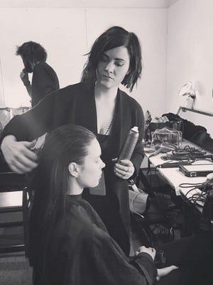 Menomonee Falls resident and hair designer for Pink Lemonade Salon, Heidi Kloeckner, styles hair during New York Fashion Week for designer Marcel Ostertag on Sunday, Feb. 12.