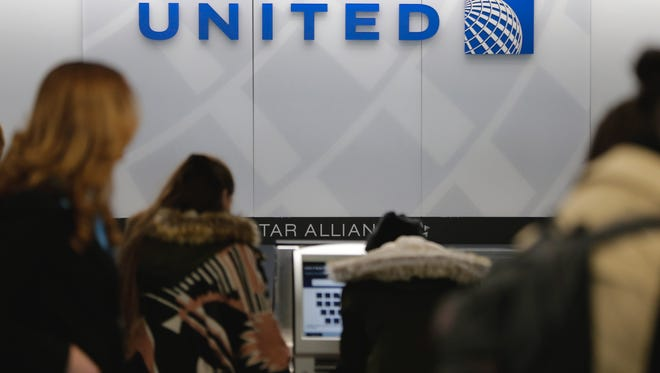 A United Airlines counter is pictured at New York's LaGuardia Airport.