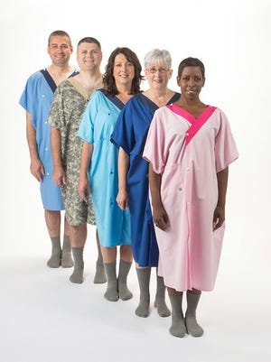 Models show off Henry Ford Health System's new snap-in-the-front hospital gown.