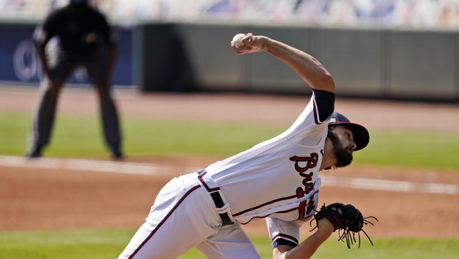 Atlanta Braves starting pitcher Ian Anderson throws against the Cincinnati Reds in Game 2 of a National League wild-card baseball series, Thursday, Oct. 1, 2020, in Atlanta.