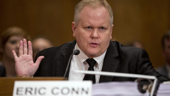 Attorney Eric Conn invokes his Fifth Amendment rights against self-incrimination during a 2013 Senate hearing. A report released by congressional investigators accused Conn of colluding with a judge to improperly award disability benefits to hundreds of applicants.