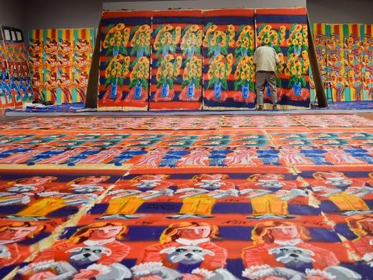 Steve Keene's art covers the Rauschenberg Gallery walls