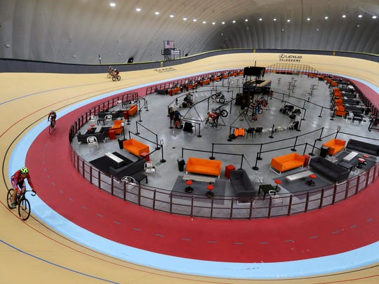 In a photo from Thursday, Jan. 18, 2018, riders cycle in the Lexus Velodrome in Detroit. The indoor cycling track is expected to draw bike riders from other cold-weather states and across the U.S. while giving inner-city youth an opportunity to participate for free in the fast-moving and growing sport. The Lexus Velodrome joins a training facility in Colorado Springs and a venue in Los Angeles as the only indoor velodromes in the U.S.
