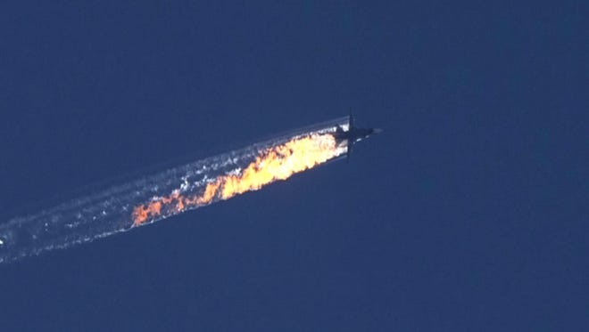 Turkey shot down a Russian military jet near the Turkish-Syrian border, Nov. 24, 2015. the image is a still from video provided by the HaberTurk TV Channel.