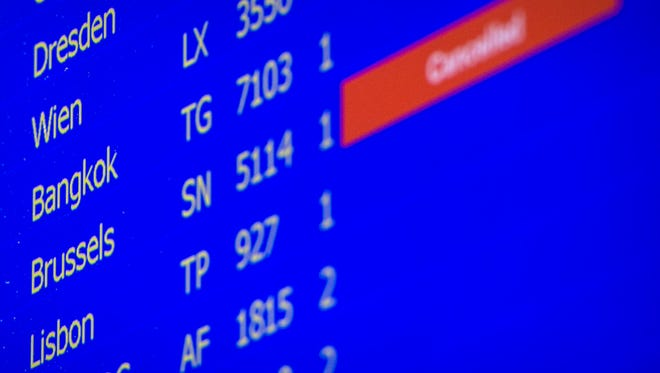 A departure board at the Zurich Airport shows a canceled flight to Brussels on March 22, 2016.