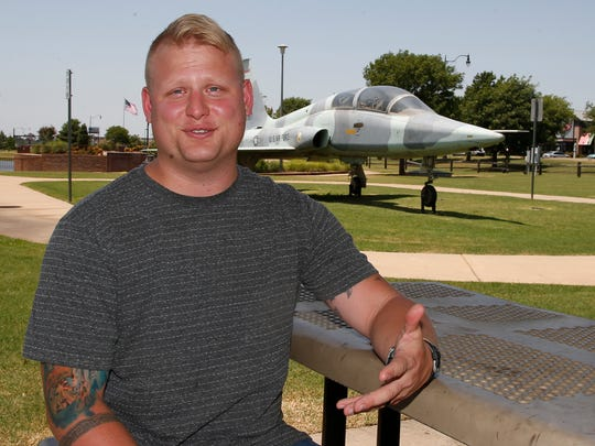 Travis Rader, a naval physical security officer, poses