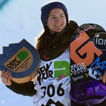 Kelly Clark takes the podium for second place at the women's snowboard superpipe final at the Dew Tour iON Mountain Championships in Breckenridge, Colo.
