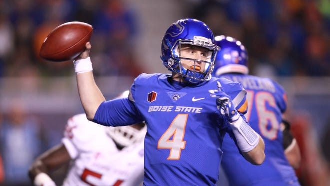 Boise State Broncos quarterback Brett Rypien (4) throws a pass downfield  during the first half of the Mountain West championship game against Fresno State Bulldogs at Albertsons Stadium.
