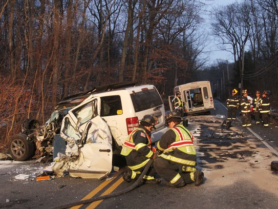 Bedford Hills firefighters work at the scene of an