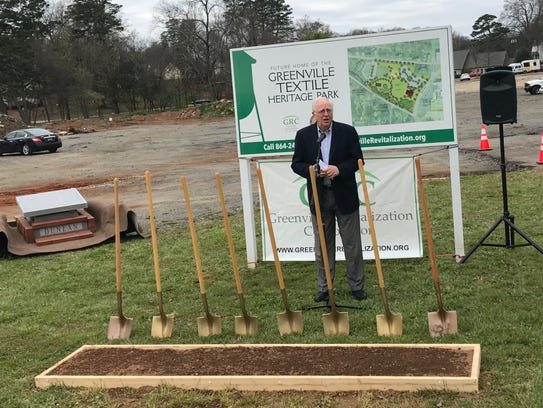 Don Harkins, chairman of the Greenville Textile Heritage Society, speaks at the groundbreaking for the Greenville Textile Heritage Park outside Monaghan Mill.