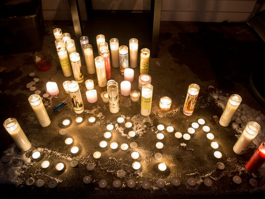 Candles are lit for a vigil for Samantha Stein Saturday,