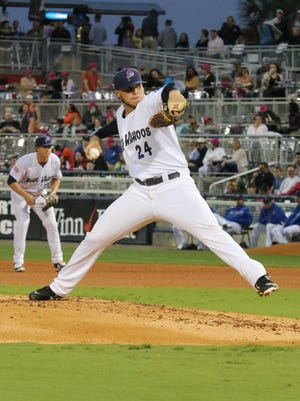 Pensacola's Rookie Davis pitches against the Jacksonville Suns Saturday night at Blue Wahoos Stadium.