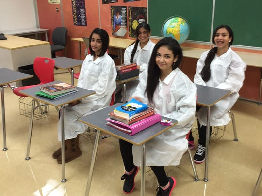 Wilkinson Middle School eighth graders whose experiments are being launched into space are, front row from left, Farah Sabah, 14, and Regina Alsabagh, 14; and back row, from left, Israa Alfadhli, 13, and Maryam Kafra, 13.