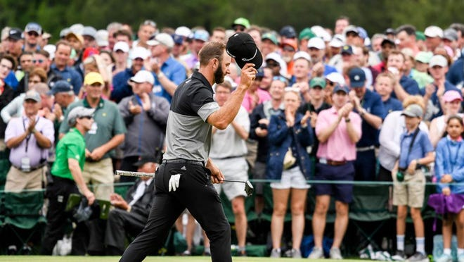Dustin Johnson waves to the patrons on #18 during the final round of the Masters Tournament at Augusta National Golf Club, Sunday, April 14, 2019, in Augusta, Georgia.