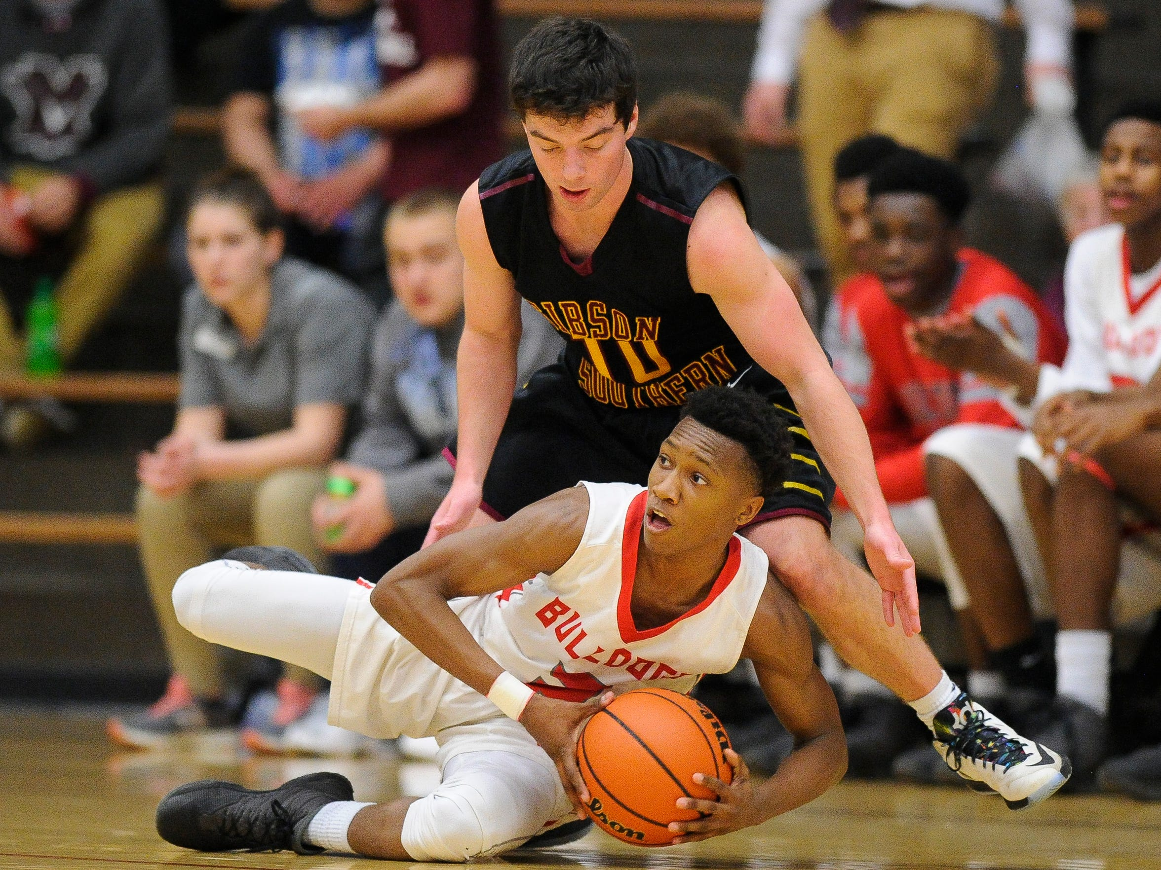 Bosse's Mekhi Lairy (2) steals the ball from Gibson Southern's Chandler McKee (10) during the Class 3A Boonville sectional quarterfinals at Boonville High School, Tuesday, Feb. 28, 2017. Bosse beat Gibson Southern 78-54.