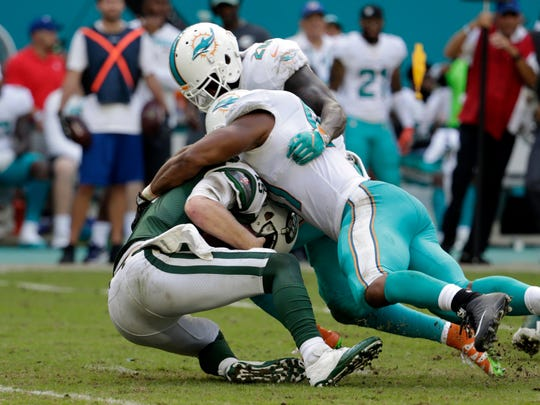 Miami Dolphins defensive end Cameron Wake (91) sacks New York Jets quarterback Josh McCown (15), during the second half of an NFL football game, Sunday, Oct. 22, 2017, in Miami Gardens, Fla. Miami Dolphins free safety Reshad Jones (20) is at right. (AP Photo/Lynne Sladky)