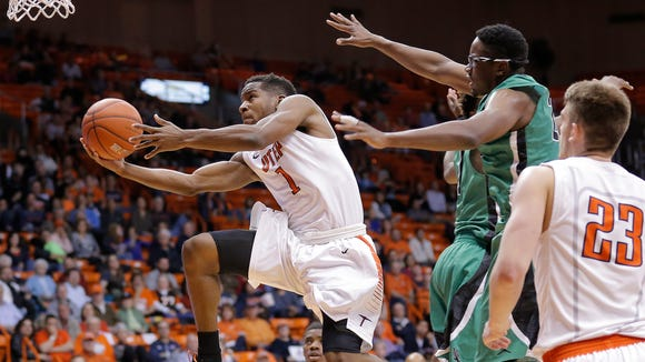 UTEP guard Dominic Artis flies through the North Texas defense to the hoop Sunday afternoon at the Don Haskins Center. UTEP defeated North Texas 84-75.