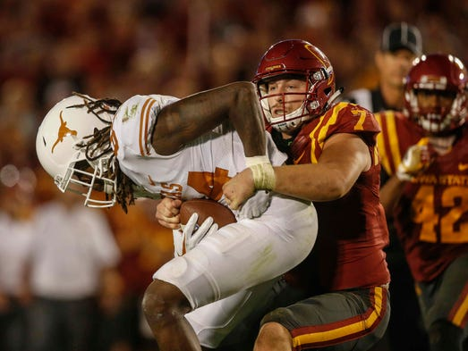 Iowa State linebacker Joel Lanning tackles Texas receiver