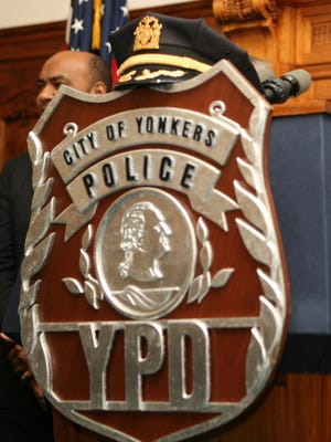 Photo of Yonkers police badge and  uniform hat at a police promotion ceremony at Yonkers City Hall, Jan. 31, 2013.