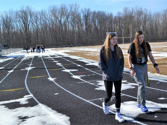 Nicole Coleman and Makayla DeGrave were among about 75 Oconto High School students to  walk around the track during the national student walkout on March 14 to protest violence in schools and stand with the victims of the school shootings in in Florida last month.