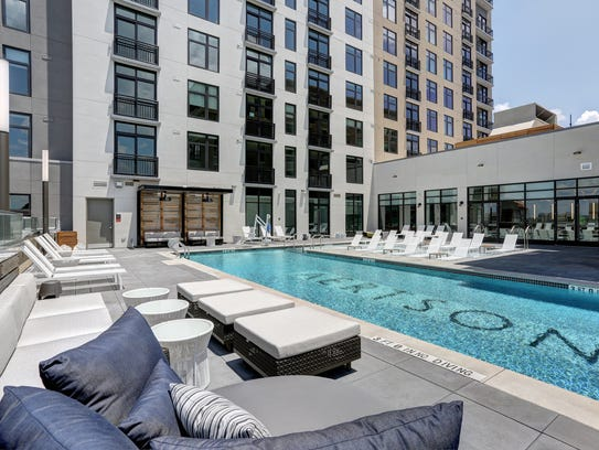 On the eighth-floor pool deck, residents can mingle