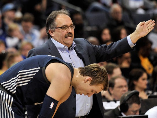 Detroit Pistons head coach Stan Van Gundy, top, talks