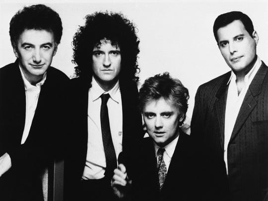 Members of rock band Queen are pictured here in 1989. From left to right are John Deacon, Brian May, Roger Taylor and Freddie Mercury,
