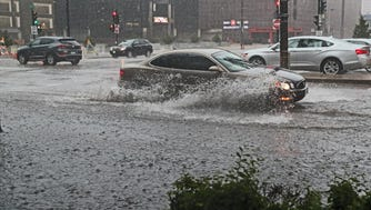 Heavy rains caused ponding on N. 6th and W. State streets in Milwaukee on Monday afternoon as thunderstorms rolled through the area.