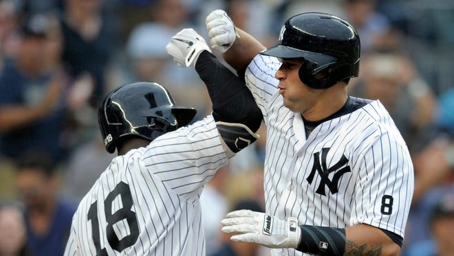 New York Yankees' Gary Sanchez, right, celebrates with Didi Gegorius after hitting a home run during the sixth inning of a baseball game against the Tampa Bay Rays Saturday, Sept. 10, 2016, at Yankee Stadium in New York.