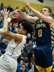 Irondequoit's Patrick Thomas, left, grabs a rebound in front of Wayne's Nick Carmichael during the Class A regional qualifier played at Rush-Henrietta High School, Wednesday, March. 7, 2018.