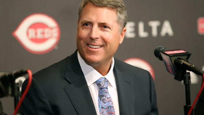 New Cincinnati Reds manager Bryan Price, smiles as he answers questions from the media during a press conference at Great American Ball Park on Tuesday afternoon.