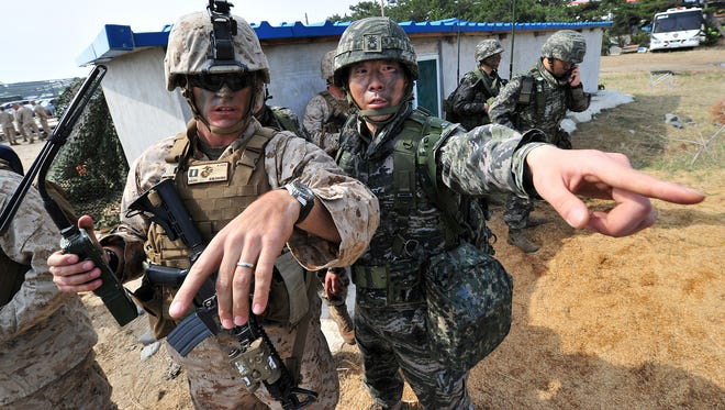 A U.S. Marine, left, and a South Korean soldier participate in a joint landing operation.