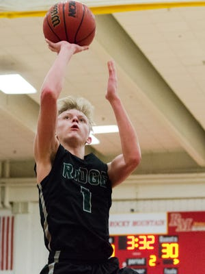 Fossil Ridge's Braxton Bertolette jumps up for a shot against Rocky Mountain High School on Tuesday. Bertolette had a game-high 26 in the win.