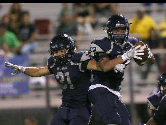 Del Valle defenders Oscar Rodriguez, left, and Gus