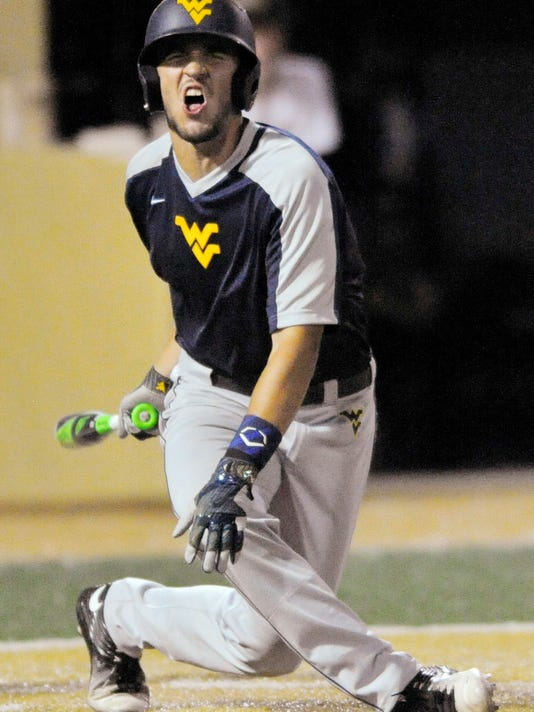 West Virginia's Darius Hill reacts to hitting a foul ball in West Virginia's 4-3 loss to Wake Forest during an NCAA college baseball tournament regional game in Winston-Salem, N.C., Saturday, June 3, 2017. (David Rolfe/Winston-Salem Journal via AP)