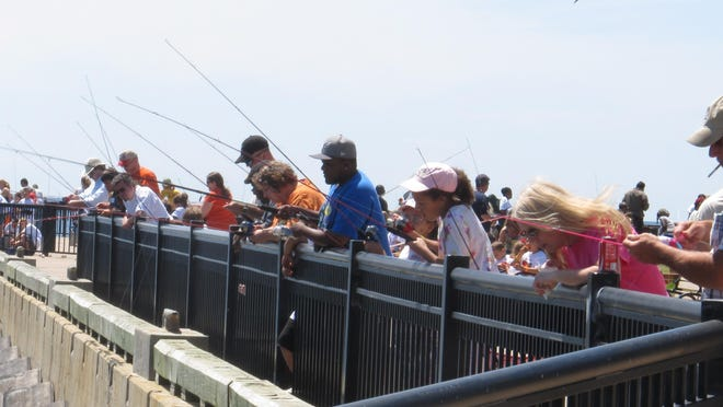 A bunch of happy anglers enjoying the day fishing at a previous Pensacola Kids Fishing Clinic.