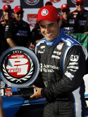 IndyCar driver Juan Pablo Montoya, of Colombia, poses with the pole award after qualifying in the first position for Sunday's Pocono IndyCar 500 auto race, Saturday, July 5, 2014, in Long Pond, Pa.